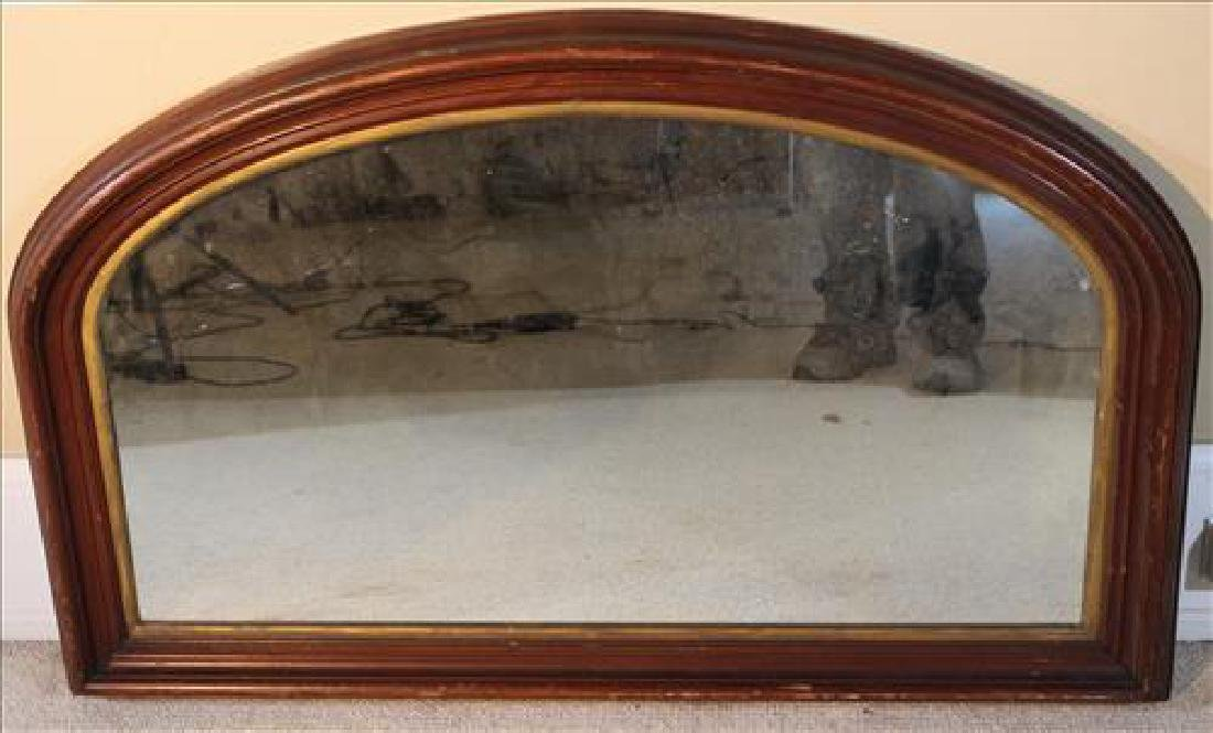 Walnut Victorian hanging mirror with oval top