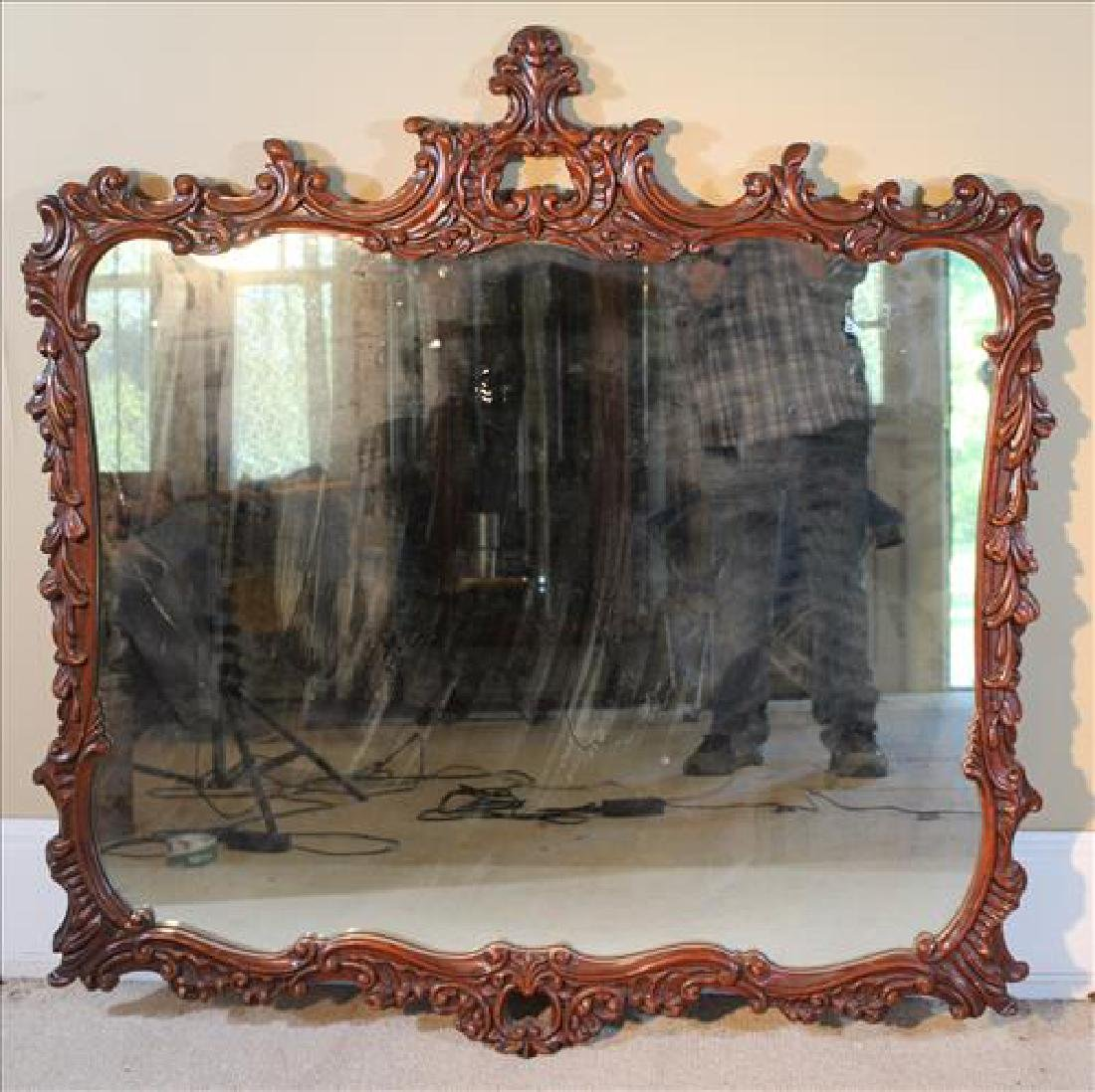 Ornate carved wood hanging mirror, 47 x 46 W.