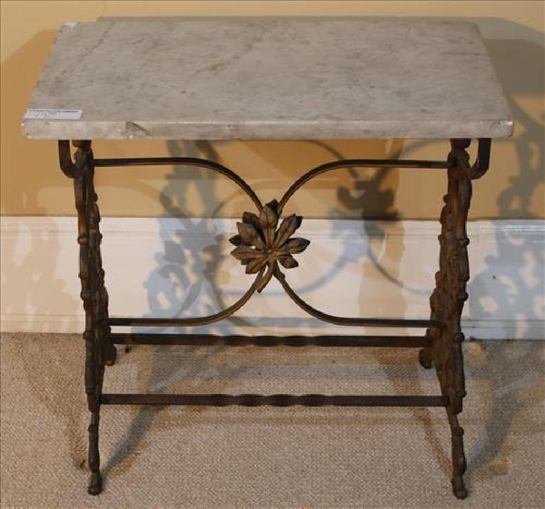 Wrought iron table with white marble and dolphin  feet