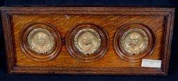 Trio of English gilt bas relief portrait rondels
