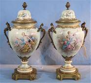 Pair of fine 19th Century scenic Sevres urns, 16 in. T.