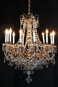 Magnificent bronze and crystal 12 arm chandelier