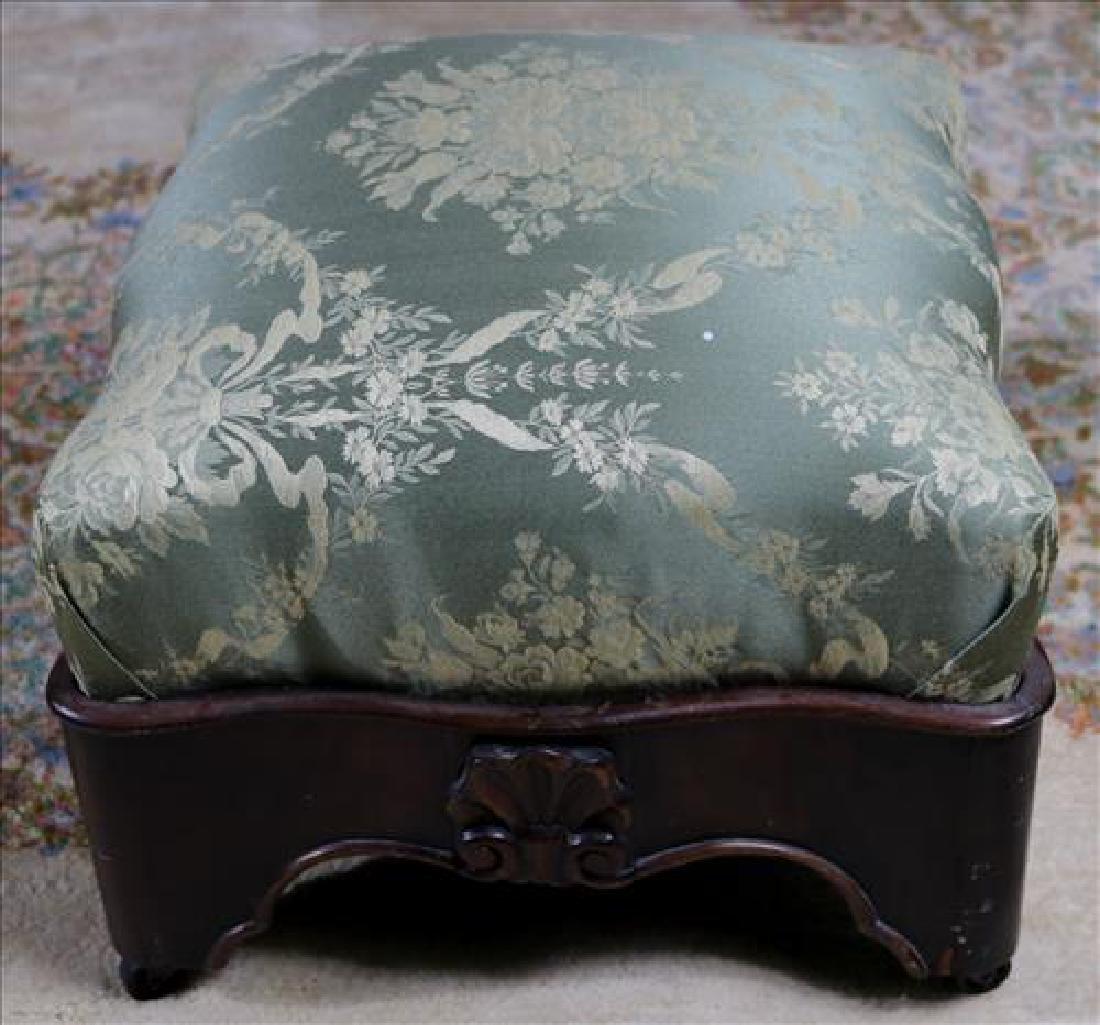 Empire mahogany footstool with green upholstery