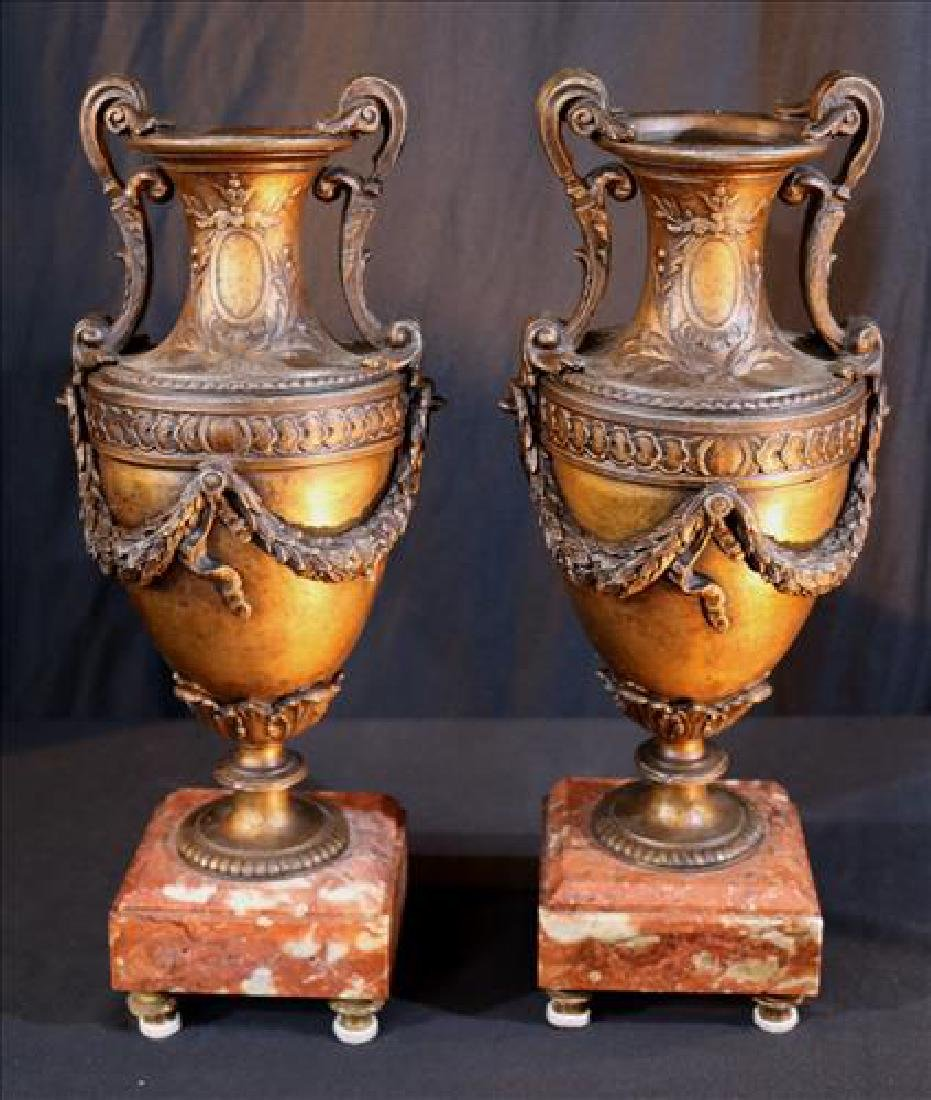 Pair metal urns  with brown marble base, 17 in. T.