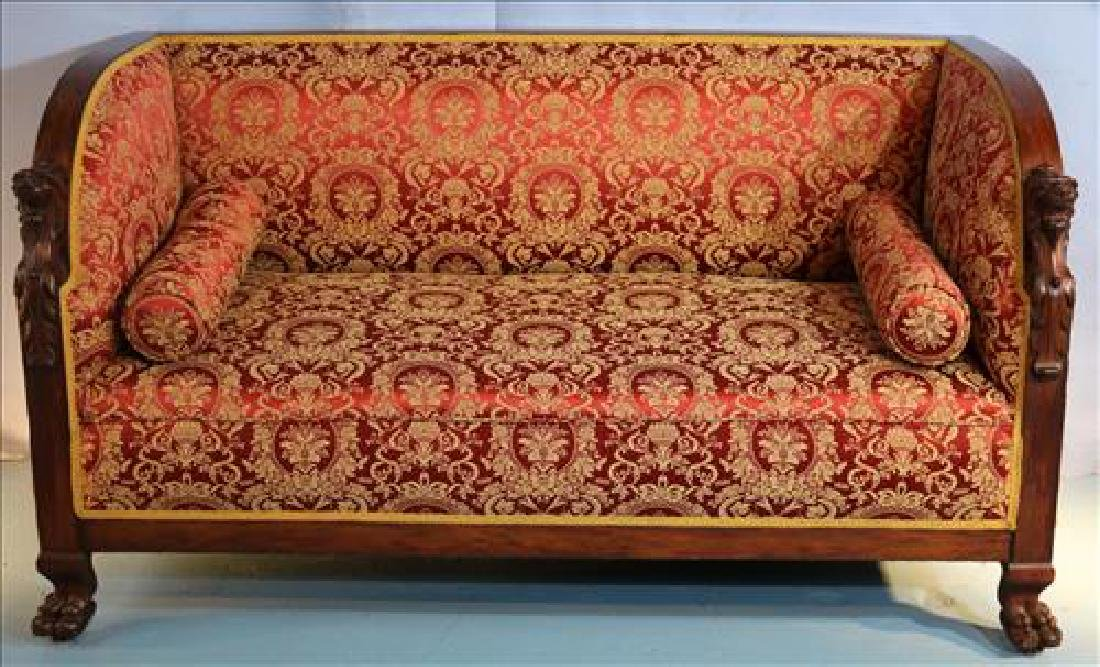 Mahogany heavily carved sofa with lion heads