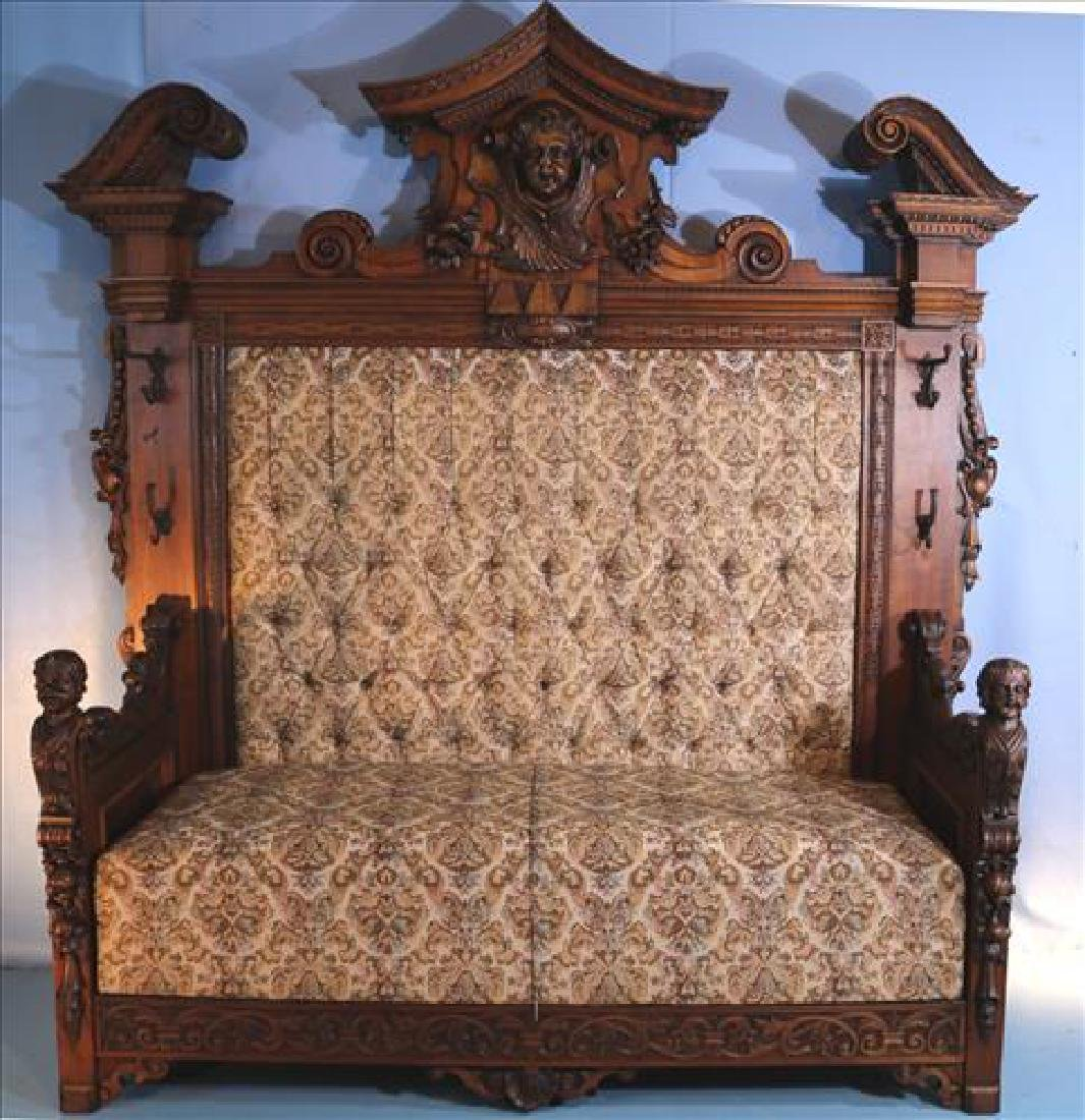 Rare heavily carved walnut hall sofa w carved faces