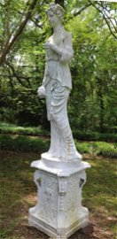 Life size cast iron garden statue on stand, 8 ft. 8 in.