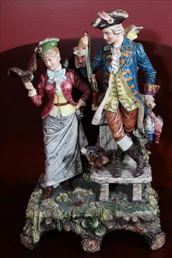 Early English porcelain figurine of man and woman
