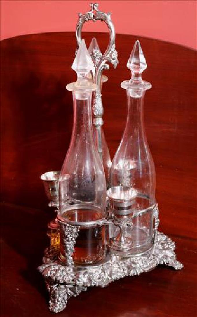Victorian silver-plate Tantalus set, 3 bottles with