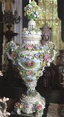 Palace size Meissen capped urn with applied flowers