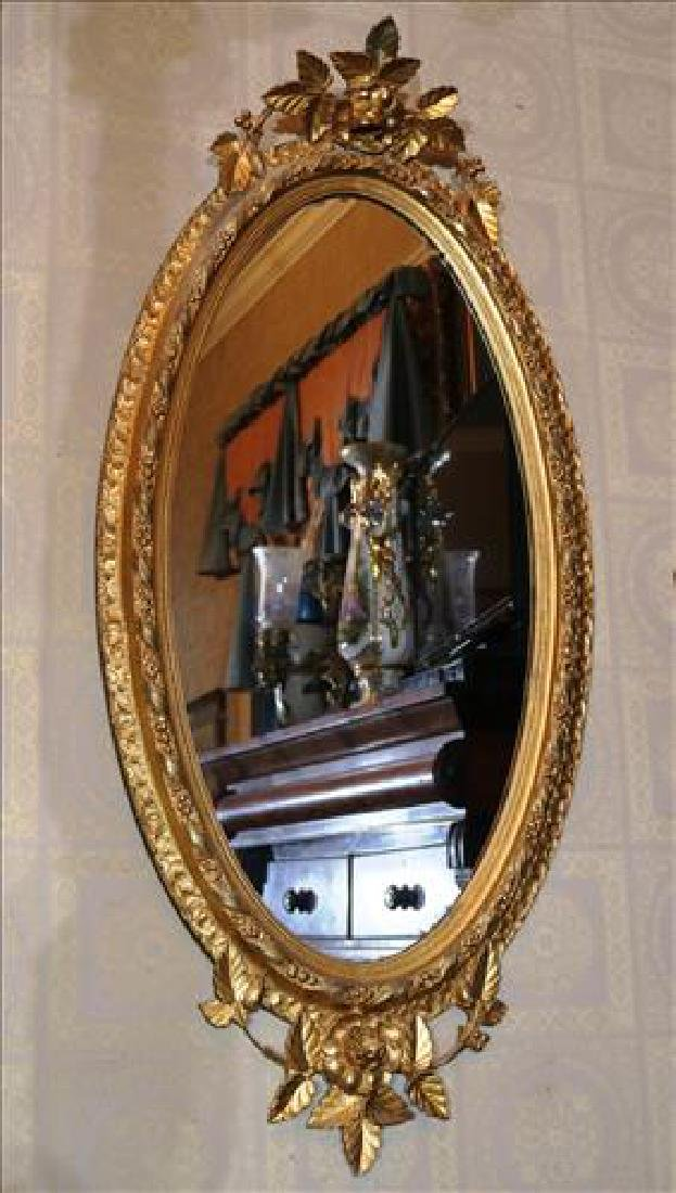 Oval Victorian hanging mirror, 56 in. T, 27 in. W.