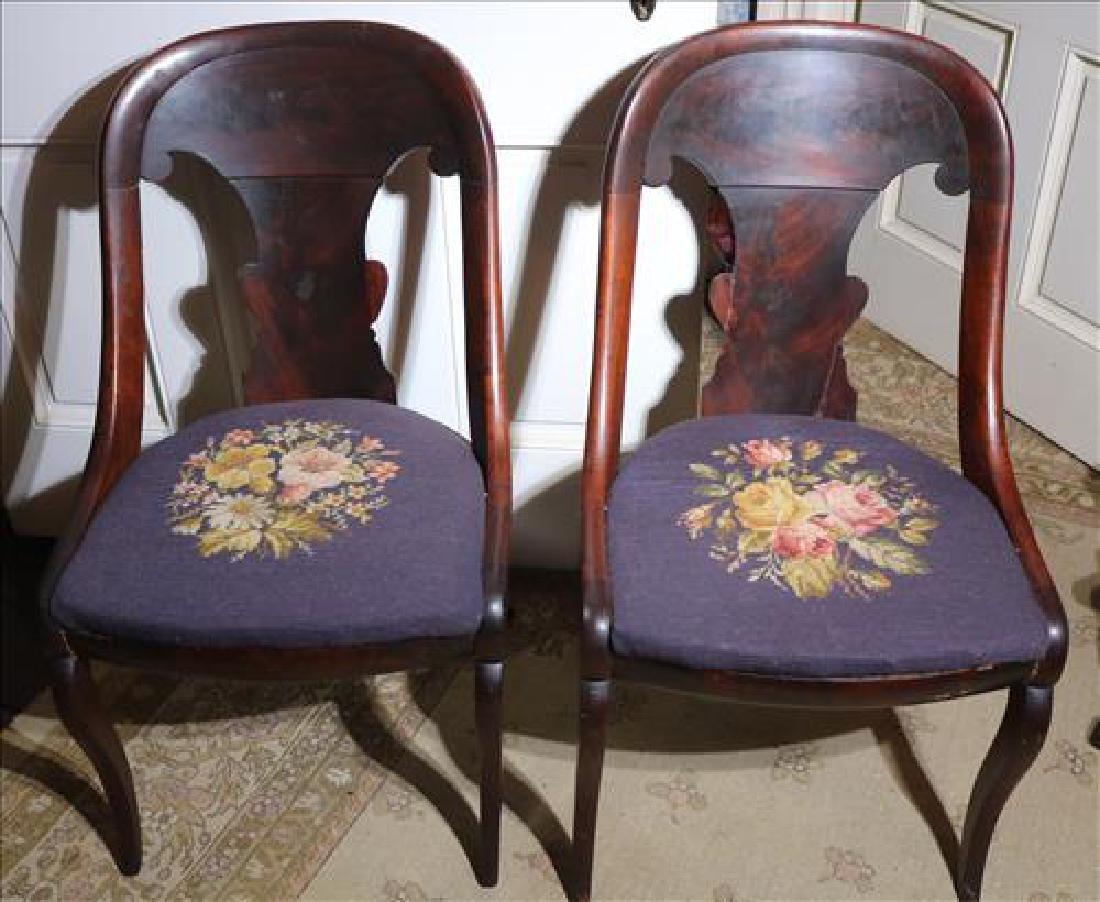 Pair Empire mahogany chairs with needlepoint seats