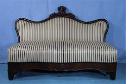 Mahogany Empire love seat with carved crown