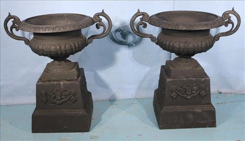 Pair of cast iron planters on stand, 28 in. T. 27 in.