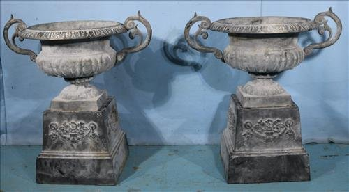 Pair of cast iron urns with handles and base, 30 in. T.