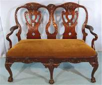 Contemporary mahogany Chippendale love seat