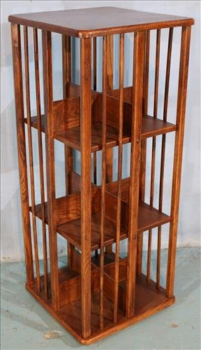 Oak revolving bookcase on stand, 43 in. T, 17  in. Sq.