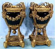 Pair heavy bronze mounted urns w porcelain bowls
