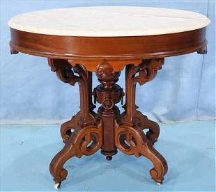 Walnut Victorian oval center table with marble