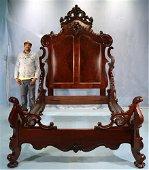 Oversized walnut rococo high back bed