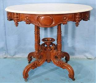 Walnut Victorian oval parlor table by T. Brooks