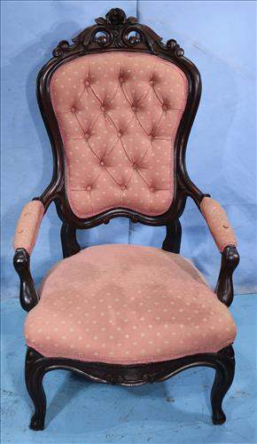Walnut Victorian arm parlor chair with crown