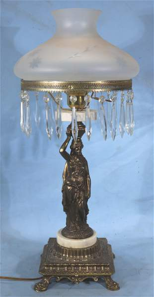 Brass figural lamp with frosted shade and prisms