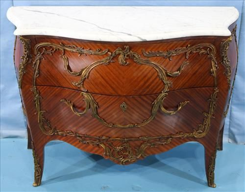 Mahogany French commode with bronze trim