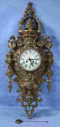 Brass French wall clock with pendulum