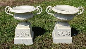 Pair of small white 2 piece urns with handles