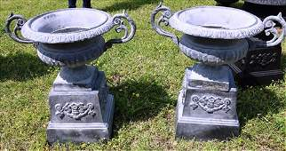Pair of small grey 2 piece cast iron urns