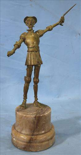 Bronze statue of Spanish soldier on marble base