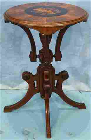 Round walnut lamp table with inlayed top
