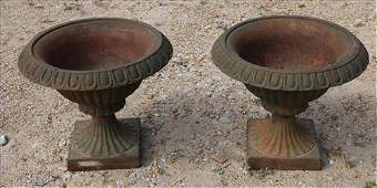 Pair of small green cast iron garden urns, 11 in. T.