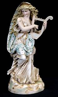German porcelain figural of lady playing a Lyre