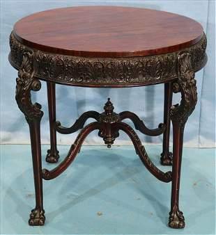 Mahogany round heavily carved lamp table