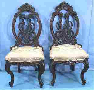 Pair of rosewood carved back parlor side chairs