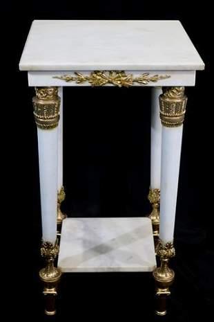 Pure white alabaster pedestal with gilt bronze