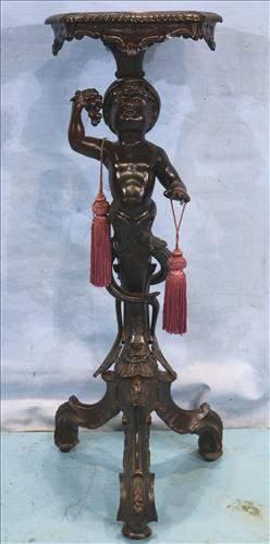 Mahogany figural pedestal with boy eating grapes