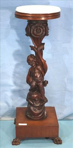 Carved mahogany pedestal with cupid and marble