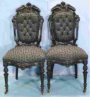 Pair of ebonized Victorian side chairs with crest