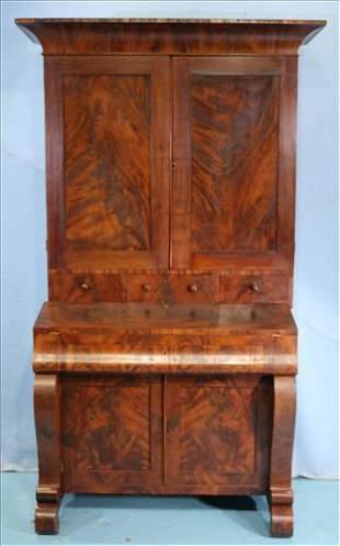 Mahogany blind door secretary with scroll feet