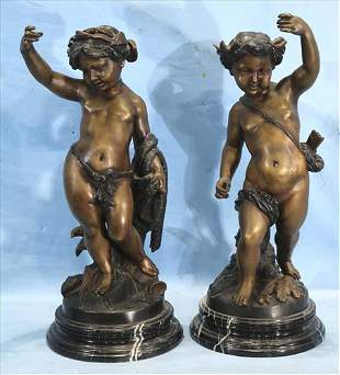 Pair of bronze statues of putti on marble base