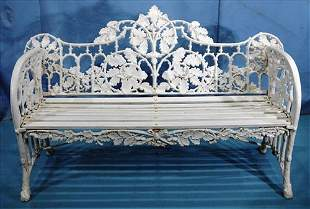 Cast iron garden bench with leaf pattern in back