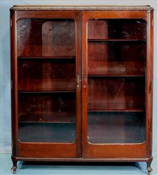 Mahogany 2 door bookcase with carving on top