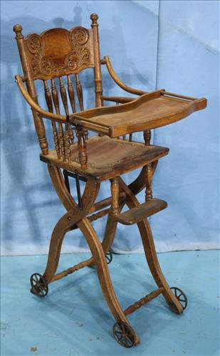Old oak high chair that lowers to a stroller