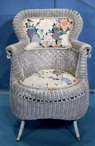 Old wicker arm porch chair