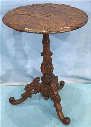 Mahogany heavily carved lamp table