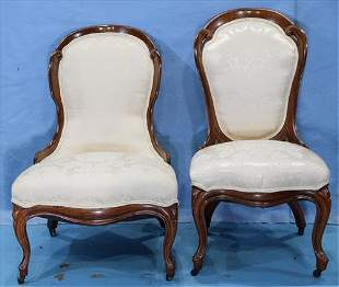 Pair of dish back rosewood side chairs by Belter