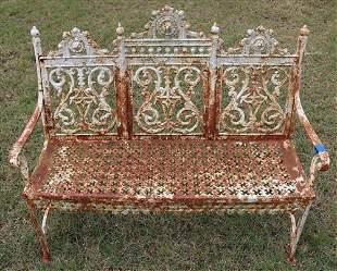 Old cast iron garden bench, 44 in. W, 36 in. T.